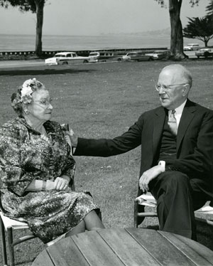 Roy and Rachel Hunt sitting side by side on a lawn, his hand placed gently on her shoulder