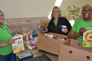 Smiling food bank workers